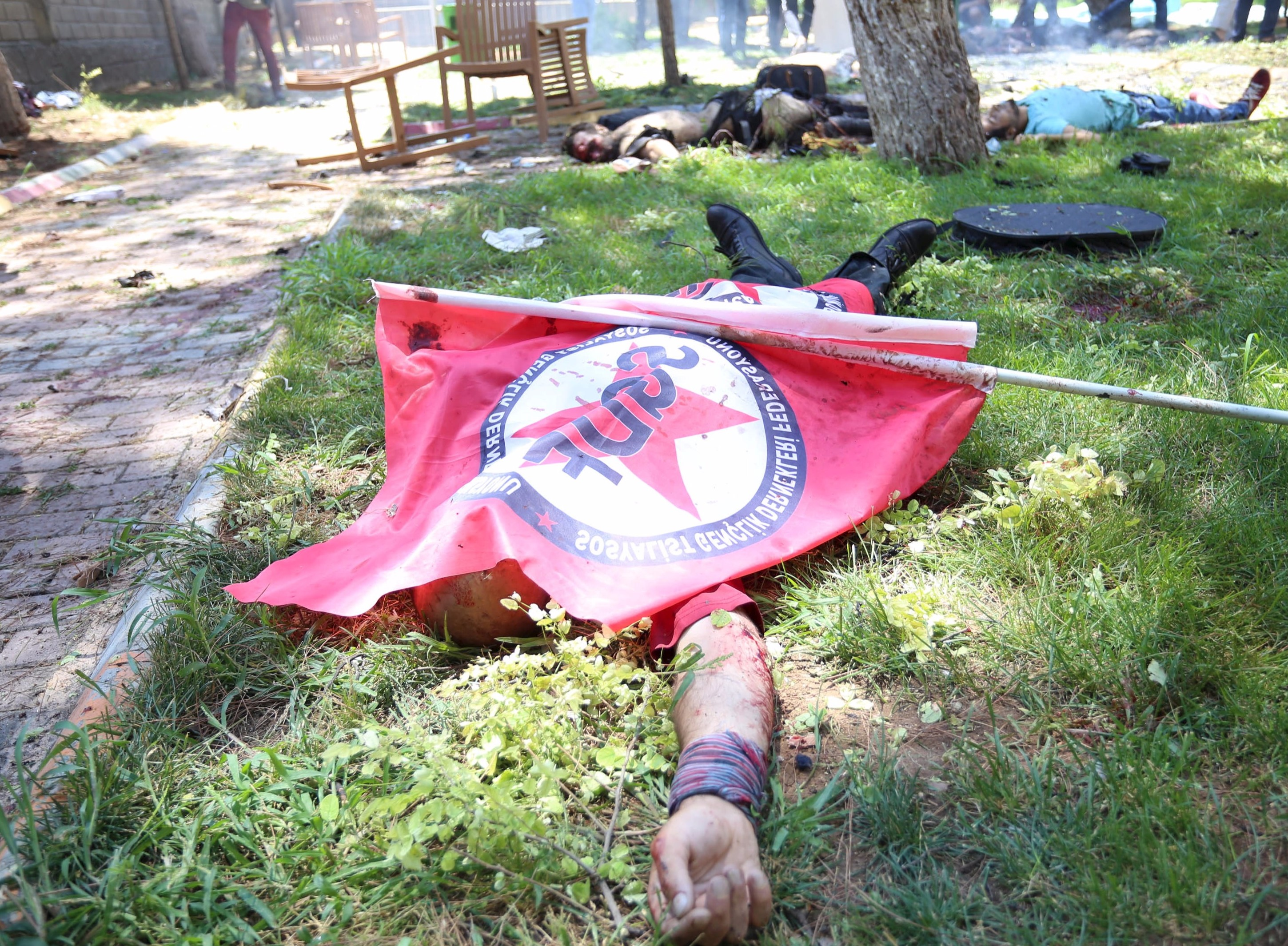 One of the casualities covered with a flag used in the rally