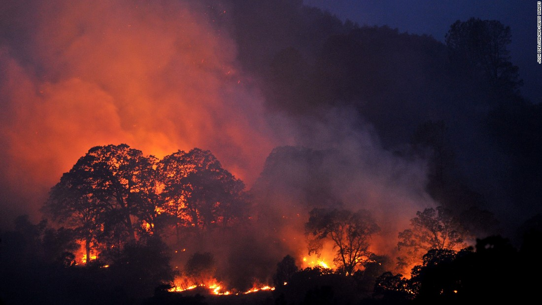 Evacuations as fire spreads near Northern California river